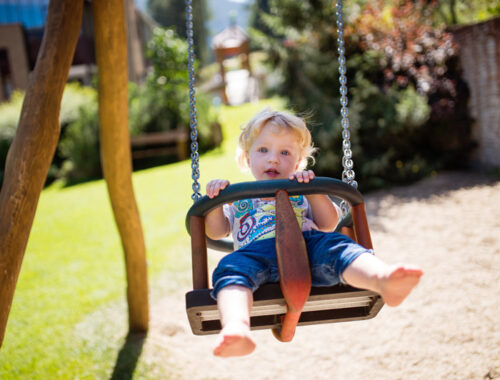 little-boy-on-the-swing-at-the-playground-PZ5DNSW.jpg
